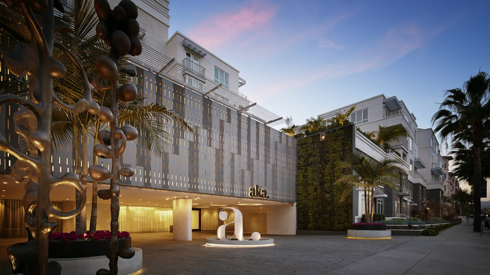 AKA Street Level View of Lobby - Sunset background with Palm Trees
