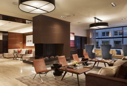 AKA Washington DC Lobby - Open Luxury With Beige Marble Flooring and Modern Chairs and Sofas