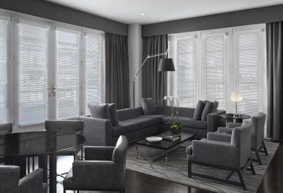 AKA Washington DC Luxury Apartment Indoor Furnishings - Grey Couch and Chairs with Brown Hardwood Floors